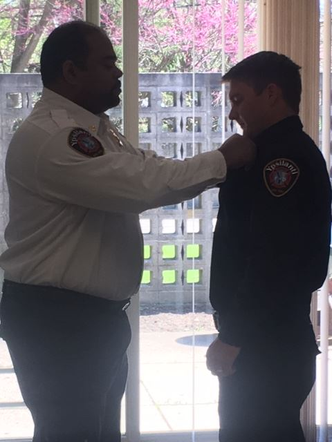 FF B. King receiving his badge